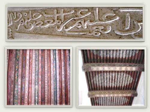 Close up of the ceiling paintings and wall carvings.